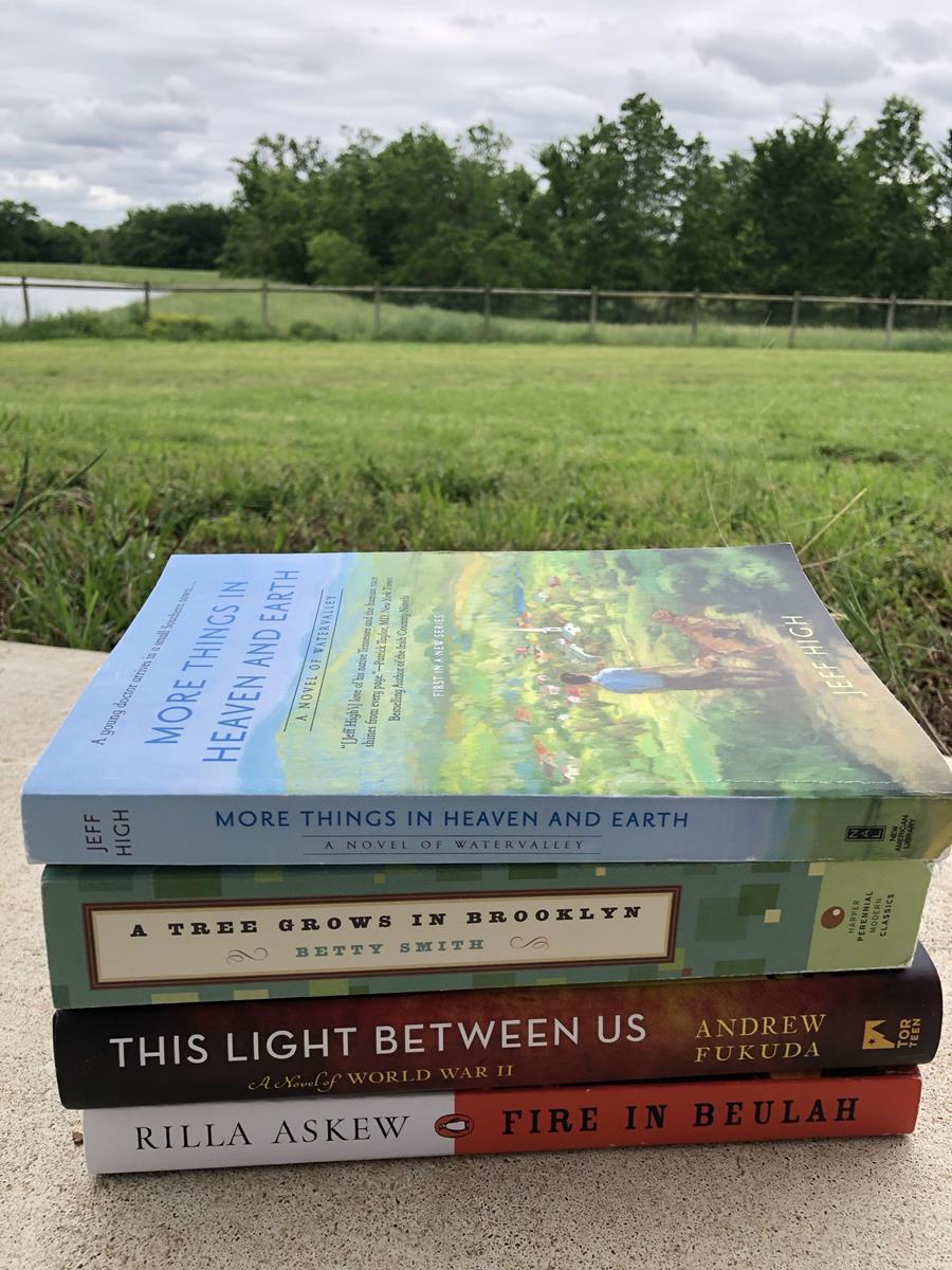 April Reads Backlist Books Challenge book stack